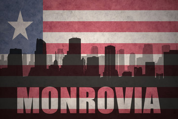 abstract silhouette of the city with text Monrovia at the vintage liberian flag