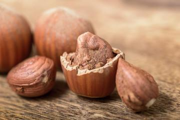 macro hazelnut and nutshell on wooden table