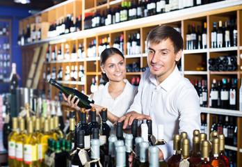 Couple buying bottle of wine