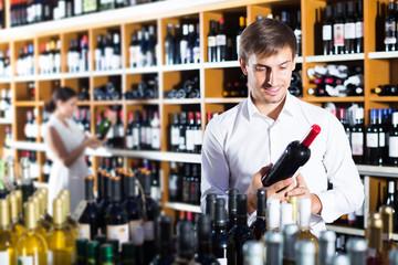 Man choosing bottle of wine