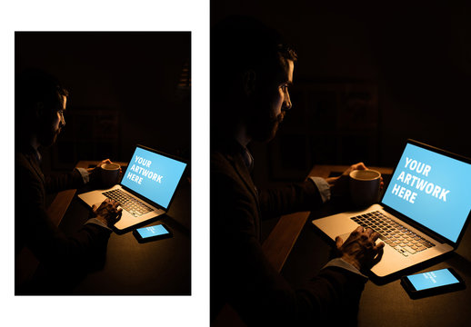 User with Laptop and Smartphone in Dark Room Mockup 1