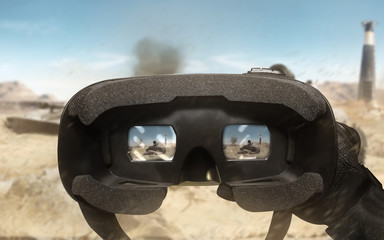 First person view soldier hand in black battle gloves & tactical jacket using vr glasses on desert tank war scene with health & armor indicator.