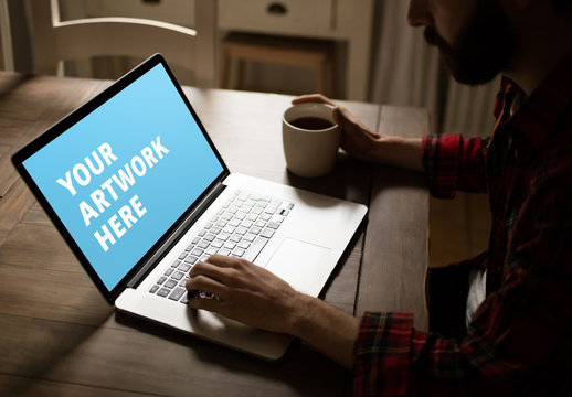 User with Laptop on Rustic Table Mockup