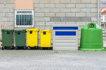 yellow and green street garbage containers