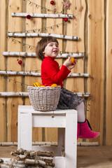 joyful girl with basket of tangerines
