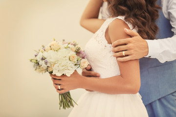 Wedding couple with beautiful bouquet of flowers, close up view