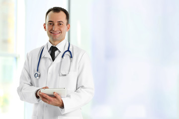 Doctor with tablet at hospital