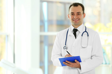 Doctor with clipboard at hospital