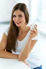 Woman Holding Drinking Yoghurt Indoors. Healthy Nutrition