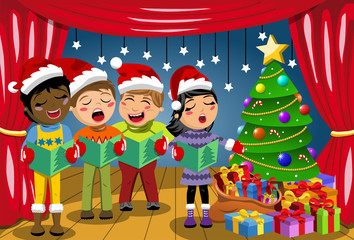 Multicultural kids wearing xmas hat singing Christmas carol nativity play stage