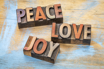 peace, love and joy in wood type