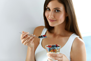 Healthy Breakfast. Woman With Glass Of Yogurt, Berries And Oats