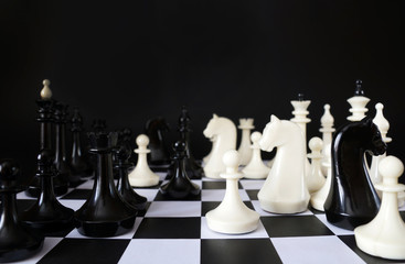 Chess game. Chess pieces against black background