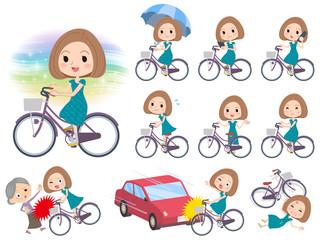 Bob hair green dress women ride on city bicycle