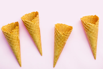 Flat lay ice cream cones collection on pink  background . Blank