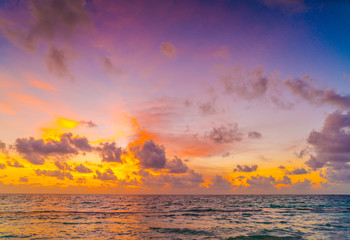 Beautiful sunset with sky over calm sea  in tropical Maldives is