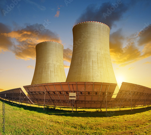 """Solar energy panels and nuclear power plant at sunset."""" Stock photo ..."""