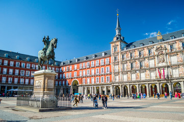 Stores photo Madrid Felipe III statue and Casa de la Panaderia on Plaza Mayor in Madrid, Spain