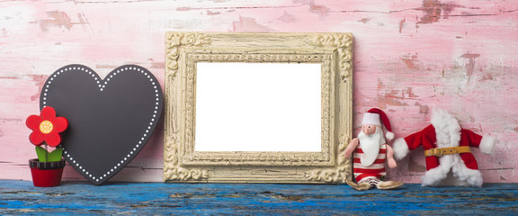 Cute Christmas photo frame. Copyspace.