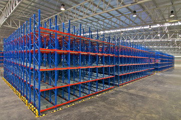 Storage system shelving metal pallet racking in warehouse.