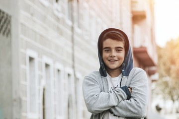 portrait of young boy in the city