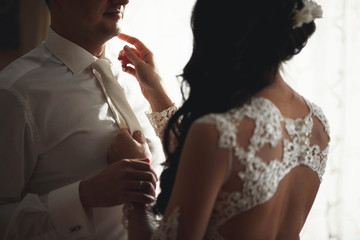young groom and his bride spends time at home