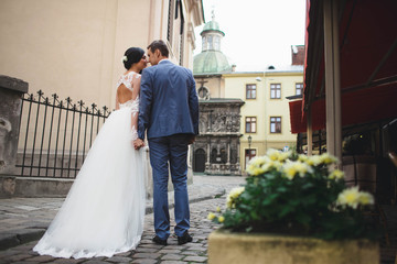 the groom and his beloved  wife walking in the large city