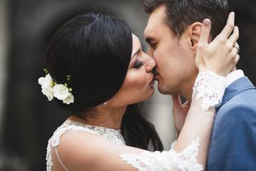 happy  bride   kissing her beloved man
