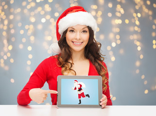 woman with santa claus on tablet pc screen