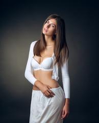The girl in underwear posing in studio