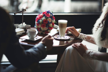 groom and his  wife  dring coffe in the morning
