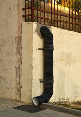 Black corrugated pipe for protection of territory from flowing down from mountain rain water in place of differential level of urban landscape