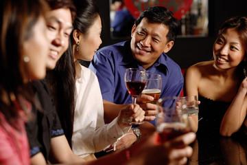 Friends having drinks at bar