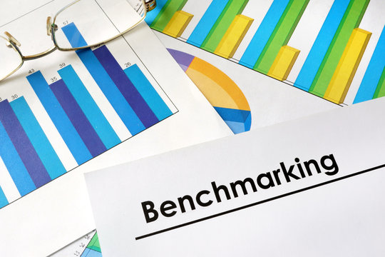 Paper with words Benchmarking and charts.