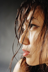 Young woman looking away, hair wet