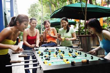 Young women playing foosball