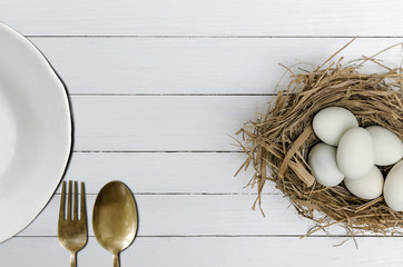 Duck eggs and white plate