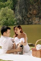 Couple having picnic by a lake