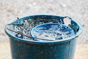 pail water dipper blue old rain water reserve
