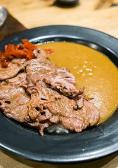 Japanese beef curry tasty in black plate