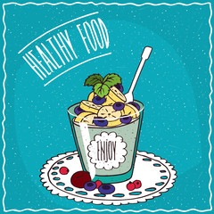 Natural yogurt with banana and blueberry in a glass, lie on lacy napkin. Blue background and lettering Healthy food. Handmade cartoon style