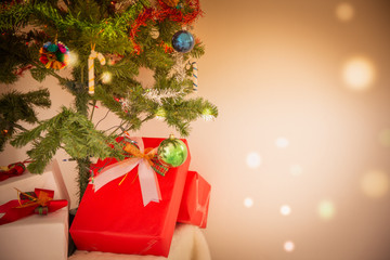 Decorated Christmas tree and gift on toned background