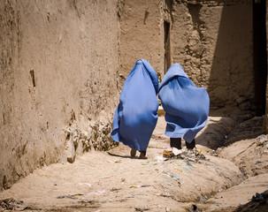 Women in burqas walking home in Kabul, Afghanistan
