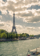 Eiffel Tower. Paris. France. Famous historical landmark on the quay of a river Seine. Romantic, tourist, architecture symbol. Toned