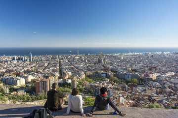 Young people enjoying the view of Barcelona from the Bunker Carmel viewpoint