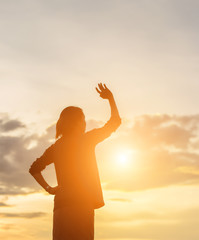 Young woman raise hands up for her success, Concept of Success i