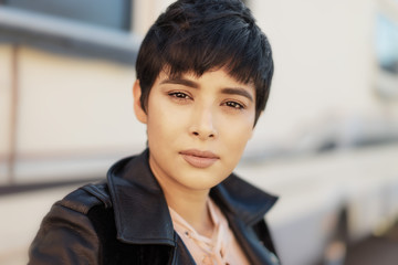 Young woman with short hairstyle, lifestyle photo.
