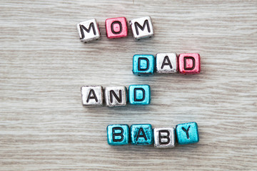 Mom dad and baby sign