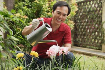 Man watering plants in the garden