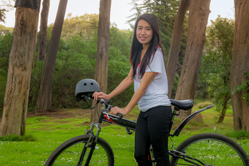 Asian gril and bikcycle